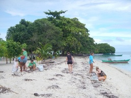 barefoot conservation volunteers doing a beach clean up